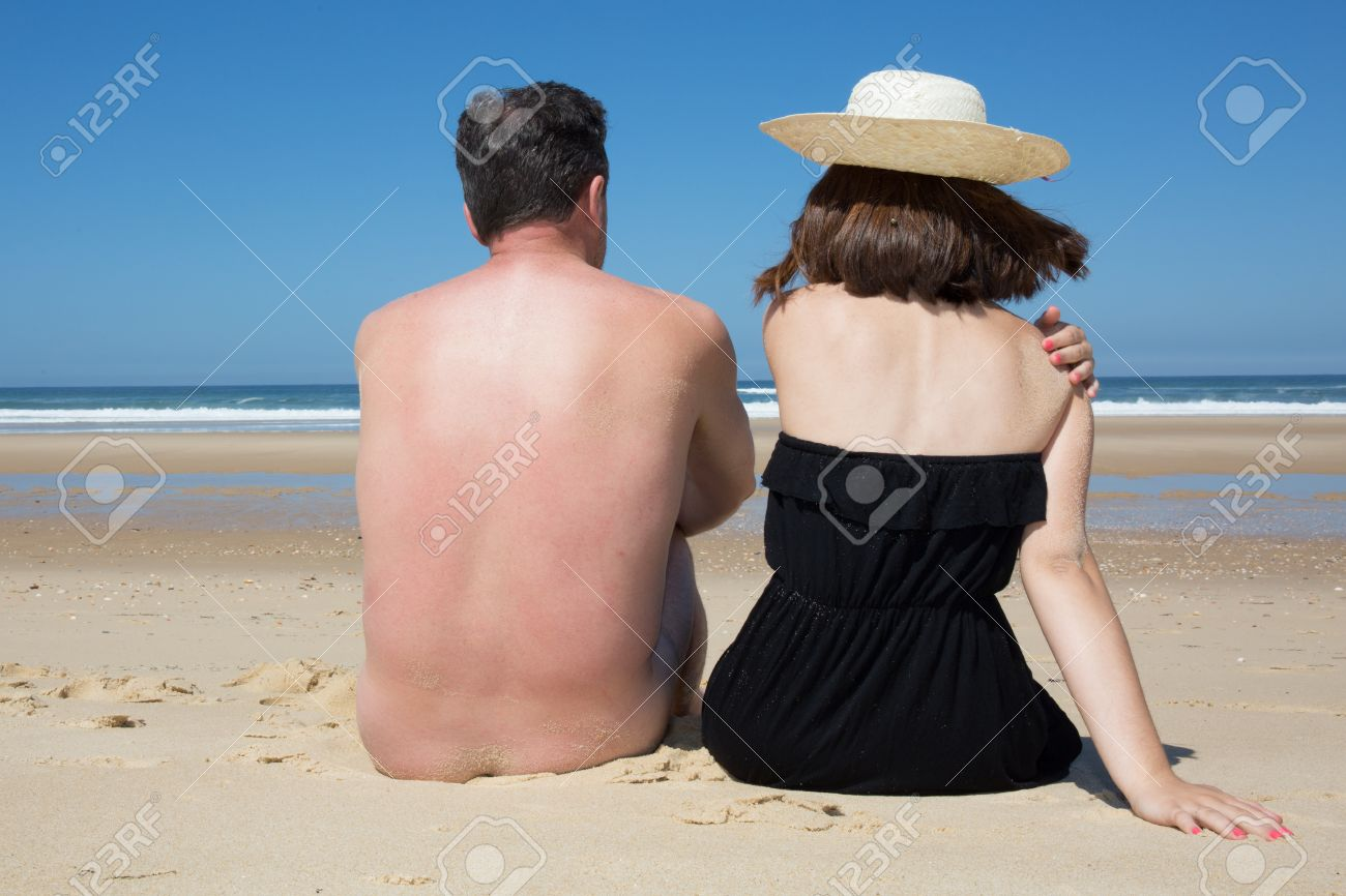 Nude man and woman on beach