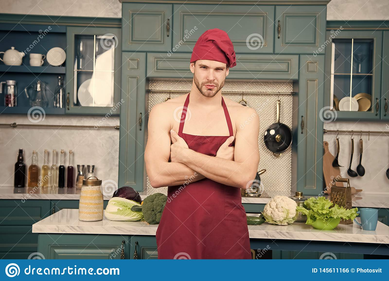 Nude guys in cooking apron